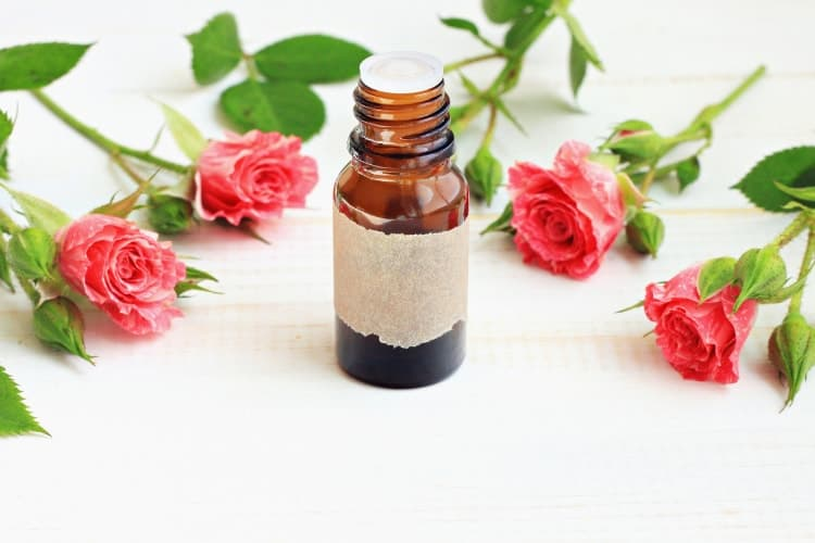 essential oils for facial steaming showing rose oil
